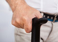 Disabled senior man with walking stick midsection closeup of Royalty Free Stock Image