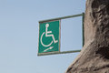 Disabled sign against the blue sky Stock Photography