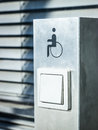 Disabled sign at a door opener Stock Photo