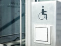 Disabled sign at a door opener Royalty Free Stock Photography