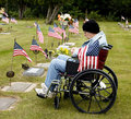Disabled vet at grave site Royalty Free Stock Photo