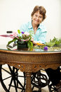 Disabled Woman Arranging Flowers Stock Image