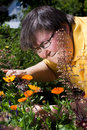 Disabled woman cuts flowers in the garden Stock Photo