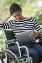 Disabled woman with Digital Tablet Royalty Free Stock Photos