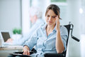 Disabled woman with headache Royalty Free Stock Photo