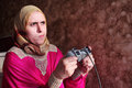 Disappointed arab egyptian muslim woman playing playstation