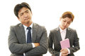 Disappointed businessman and businesswoman tired stressed asian businessmen Stock Photography