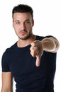 Disappointed or displeased young man doing thumb down sign attractive isolated on white Royalty Free Stock Photography
