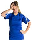 Disappointed football fan in blue jersey on white background Stock Photography