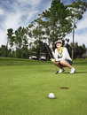 Disappointed golfer on putting green full length of female Royalty Free Stock Photos