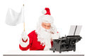 Disappointed Santa with typing machine waving flag Stock Photo