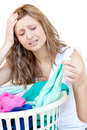 Disappointed woman doing laundry Royalty Free Stock Photography