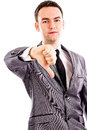 Disappointed young business man showing thumb down sign isolated on white Stock Image