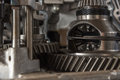 Disassembled car dirty engine and gear at garage Royalty Free Stock Photo