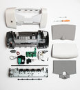 Disassembled Printer On A White Background