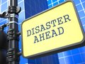 Disaster concept desaster ahead roadsign on blue background Royalty Free Stock Photography