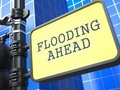 Disaster concept flooding ahead roadsign on blue background Stock Images