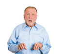 Disbelief closeup portrait senior mature man looking shocked surprised in open mouth eyes jaw dropped hands in air isolated white Stock Images
