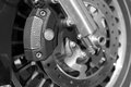 Disc brake detail of the front wheel of a motorcycle with Royalty Free Stock Image