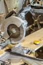 Disc electric circular saw. Sawing machine in a working carpentry workshop. Royalty Free Stock Photo