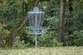 Disc golf basket and woods scoring or pole hole surrounding Stock Photo