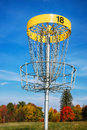 Disc golf target against blue sky Royalty Free Stock Photo