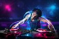 Disc jockey playing music with electro light effects and lights young Royalty Free Stock Photo