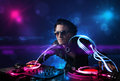 Disc jockey playing music with electro light effects and lights young Stock Images