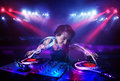 Disc jockey playing music with light beam effects on stage handsome Royalty Free Stock Image