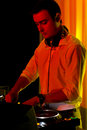 Disc jockey working in colourful party light