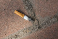 Discard a cigarette on the floor Royalty Free Stock Images