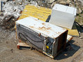 Discarded fridge and dryer in a junk pile Stock Photo