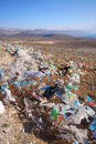 Discarded plastic bags shopping from an unguarded garbage disposal facility polluting meadows on a hill slope in croatia Stock Photography
