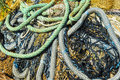 Discarded ropes nets close up view of and fishing that have been Royalty Free Stock Images