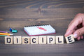 Disciple from wooden letters on wooden background Royalty Free Stock Photo