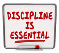 Discipline is essential words dry erase board commitment control on a to communicate the importance of being committed to a job or Royalty Free Stock Photos