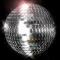 Disco ball a mirror also known as a against black with a strong spotlight Royalty Free Stock Photo