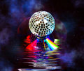Disco ball over music CD in space Stock Photography