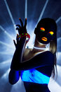 Disco girl with glow make-up dance in uv light Royalty Free Stock Images