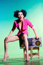 Disco girl merry with a tape recorder on the Stock Images
