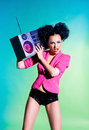 Disco girl merry with a tape recorder on the Stock Photography