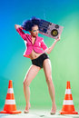 Disco girl merry with a tape recorder on the Royalty Free Stock Photography