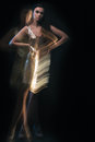 Disco girl sensual fashion portrait of young gorgeous woman in party dress with motion effect not digital manipulate Stock Images