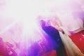 Disco lights shine over a dancing wedding couple