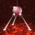 Disco party music ball on dark red background with blurry lights Stock Image