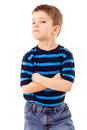 Discontent little boy in striped shirt isolated on white Stock Photo