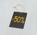 Discount gray tag label on white wooden table Royalty Free Stock Image