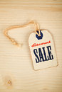 Discount sale price tag label on wooden texture background top view of vintage filter toned image Royalty Free Stock Photo