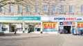 Discount shops bury st edmunds uk – january adjacent stores poundland and sports direct Stock Photo
