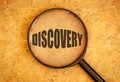 Discovery magnifying glass focused on the word Stock Images